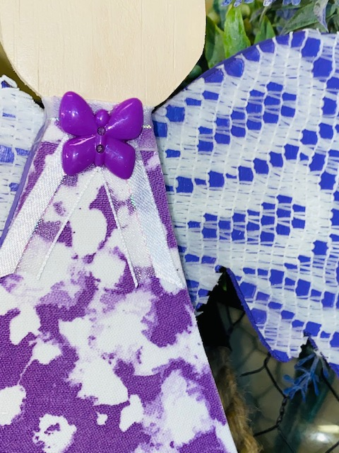 Shades of purple, wooden angel with lace and fabric decoupage.  Unclose picture of the butterfly button embellishment.