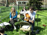 Valerie Reaper (left) and Brad Kenney entertain kids with some tunes on the Oval
