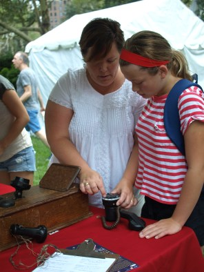 Attendees try out an old rotary phone (Photo by Maria Rocha-Buschel)