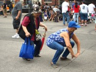 Stuy Town resident Florence Omangan and East 28th St. and First Ave. resident Maria Trinidad dance the Cotton-Eyed Joe