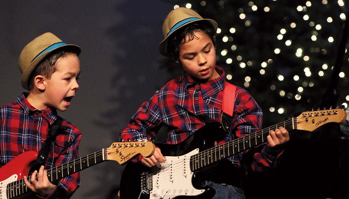 Brothers Conner and Cameron Mushero perform at the Warming Up For Christmas concert on December 3.                               Photo by Mark Huard, owner Central Maine Photography