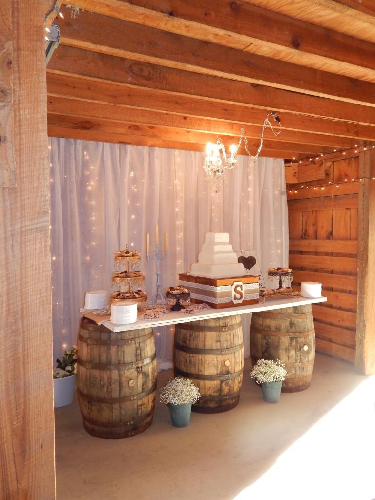 Our waterfall drapes make a great backdrop for either the cake or the head bridal table.  Here we used our whiskey keg table to contract with the crystal chandeliers.