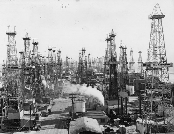 Black and white photo of oil towers