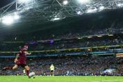 Johnathon Thurston with purchase on the ball kicking for goal from sideline real estate location during Game 2 Queensland State of Origin victory 2017