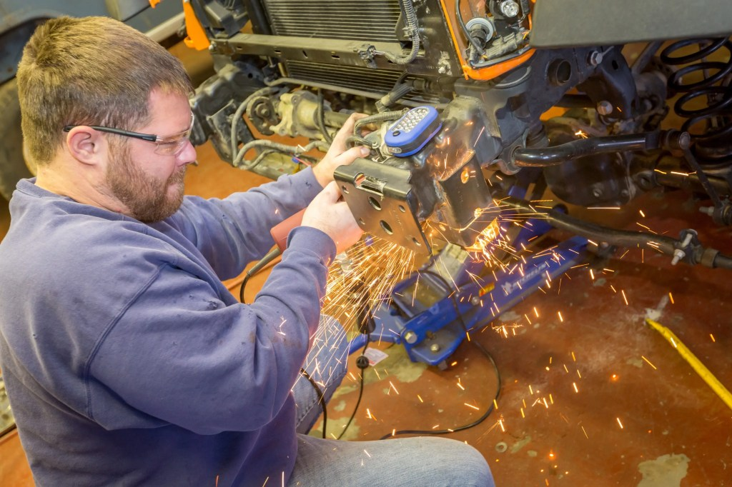 Removing the factory crash bar during the Currie Enterprises suspension system install