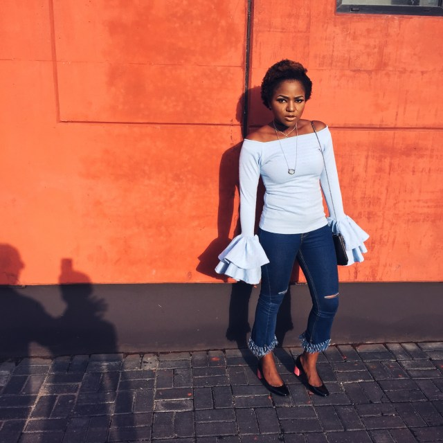 Lady wearing a blush blue double flare top