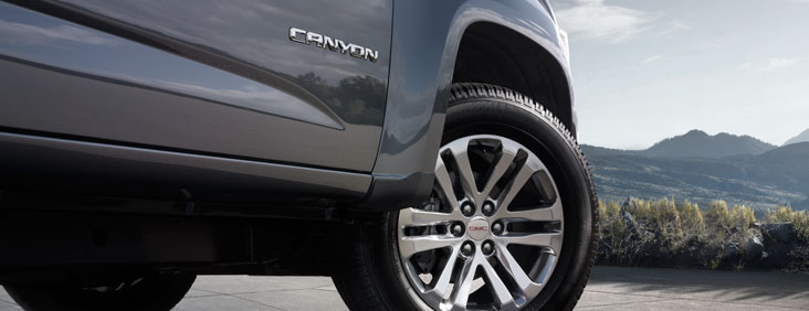 Image of the front right wheel well on the 2017 GMC Canyon small pickup truck, showing the Canyon logo text.