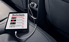 Image of a tablet plugged into the 12 volt charging port on the rear of the center console in the 2017 GMC Canyon.
