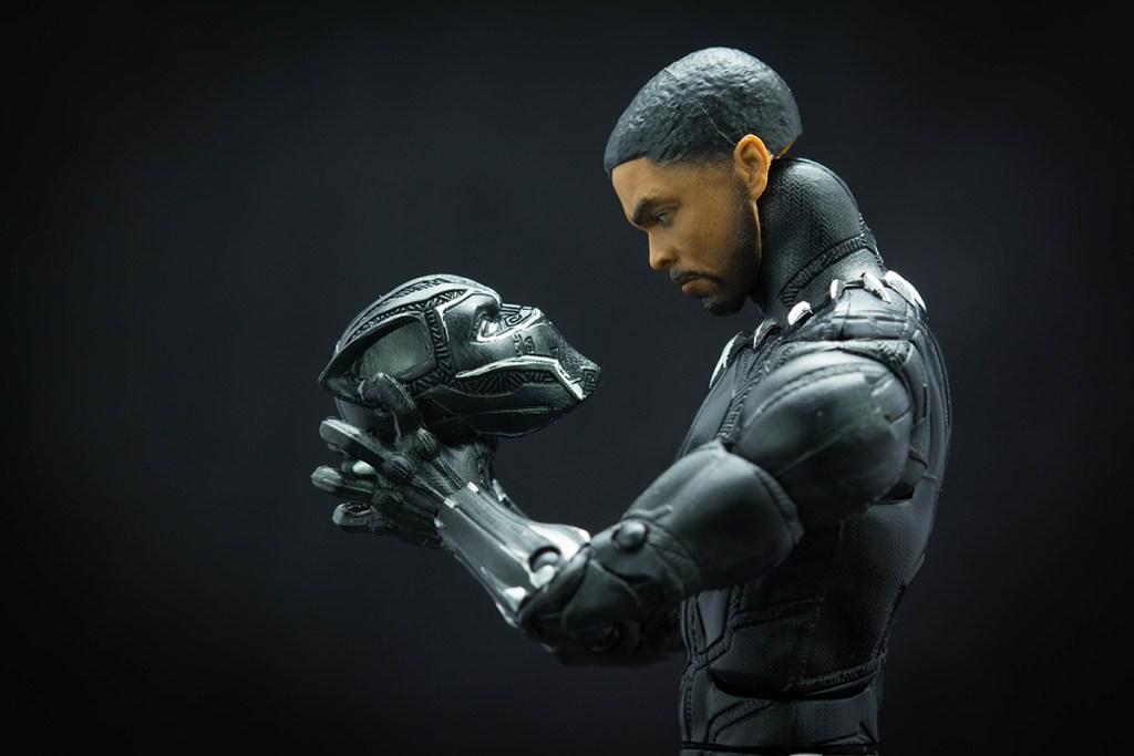 Black Panther holding mask