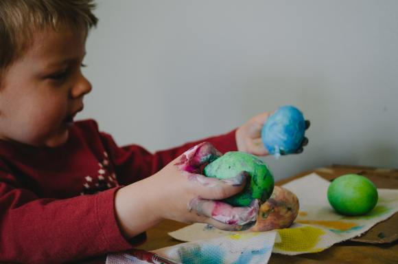 toddler making Easter eggs out of play dough. The Easter Bunny brought toys instead of chocolate.