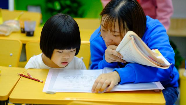 Mother and child working on unfamiliar word. Try making a meaningful guess as a strategy.