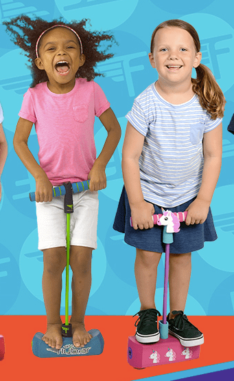 two girls on a pogo jumper, great vigorous exercise for a preschooler, one of the best toys for outdoor activities