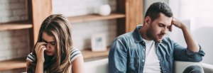 Struggling couple looking away from each other