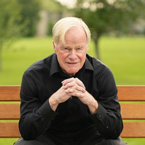 Terry Penner sitting on a park bench