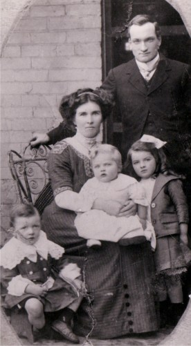 Joseph & Christina Di Saliva with Frances (standing), Keith (sitting) & Walter (baby on mother's lap)