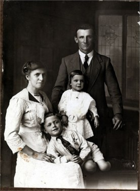 Madeleine Standing In Front of her Adored Father, with Mother and Brother