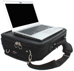 A large trabasack laptray and bag shown in black with a laptop on it's tray surface but it could easily fit an XAC on the tray surface