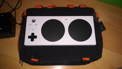 XAC Tray: An xbox adaptive controller on a trabasack mini lap tray with a velcro ready surface.