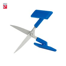 "Image is a photograph of the Peta UK table top scissors in an open position, with blue t-shaped handle on a white background. In the top lefthand corner of the image there is a small Union Flag logo with text that reads ""Made in Britain""."
