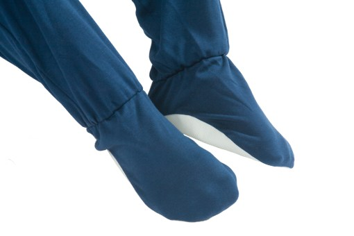 Image shows a photograph of the built-in non-sleep feet on a navy blue Seenin sleepsuit