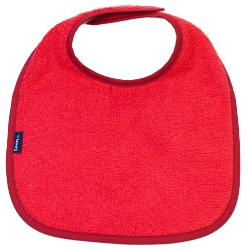 Image shows a photograph of a red, cotton towelling dribble bib lay flat on a white background
