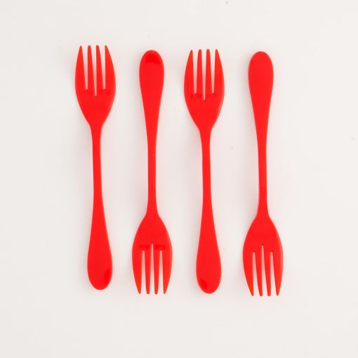 Image is a photograph of 4 red, plastic Knorks top-to-tail in a line, lay flat on a white background