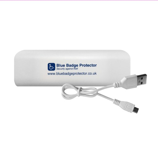 "Image is a photograph of a white, rectangular plastic power bank with USB cable. On the power bank is printed ""Blue Badge Protector"" in blue text"