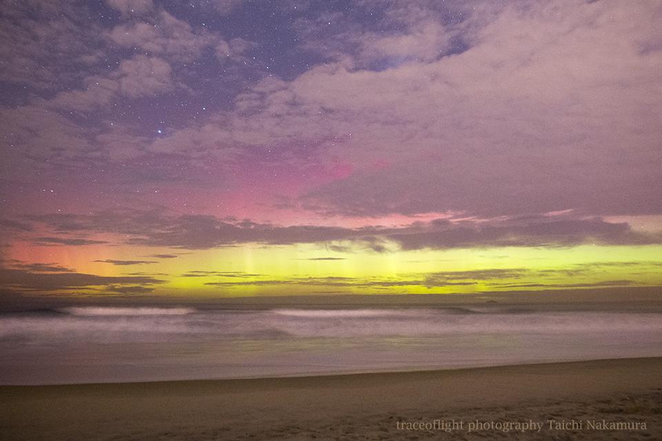Aurora at peaceful winter beach