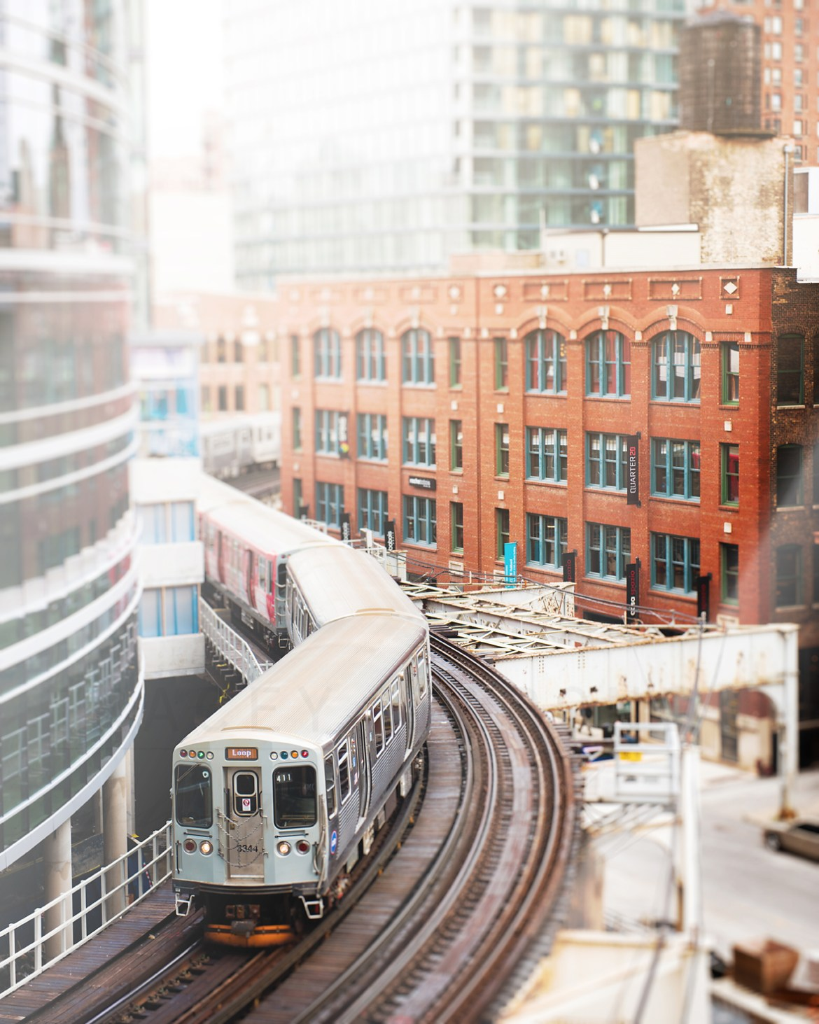 Photograph of a Brown Line CTA train from above. Chicago photography by Tracey Capone
