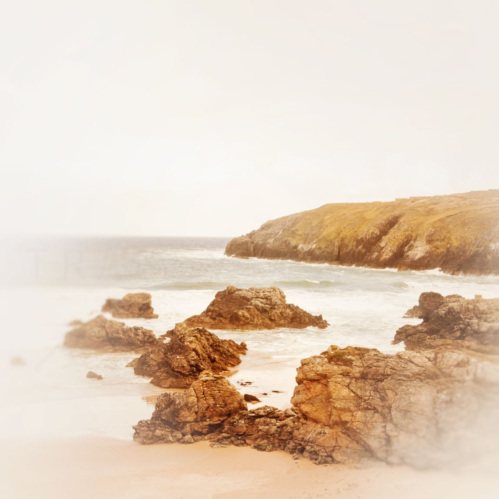 Photograph of the rugged cliffs and rocks along the shoreline in the Highlands of Scotland