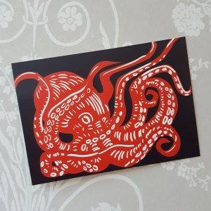 Squiddie postcard on black
