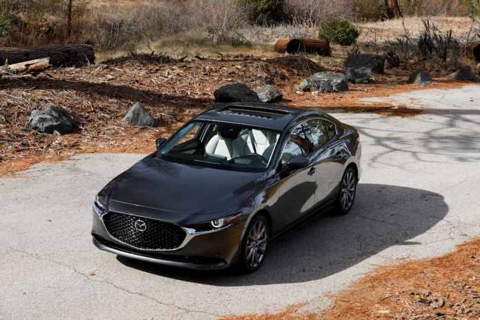 2019 mazda3 sedan top view in grey in a forest