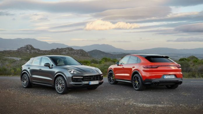 2020 porsche cayenne coupe and coupe sport side by side in mountains