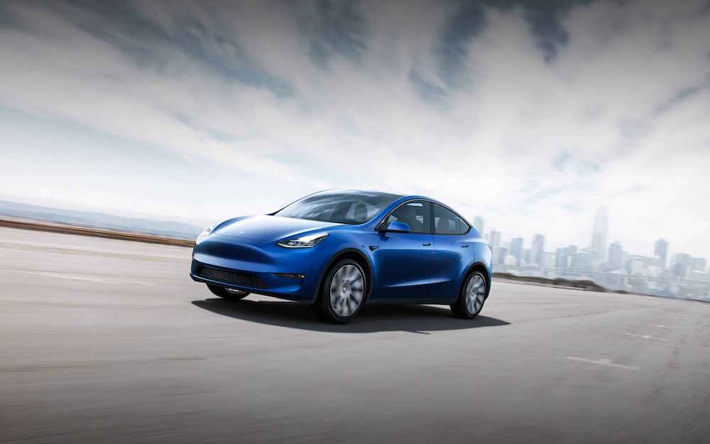 2021 Tesla Model Y in blue driving front view