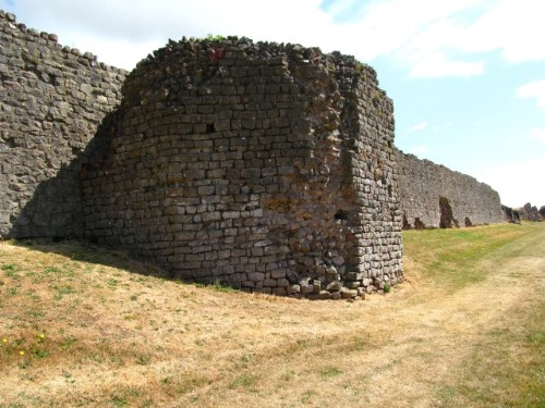 The remains of 4th century gatehouses line the walls