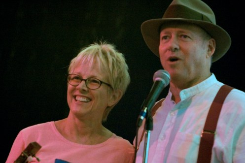 photo of Tracy Newman standing on stage with Dutch Newman