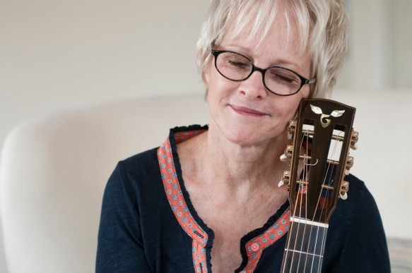 Photo of Tracy Newman and her Goodall guitar - Photo by James F. Dean.