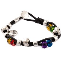 Genuine leather with Sterling Silver plated base metal and glass beads. Made in Spain. Fits wrists 7.5 inches. Lead and nickel free.