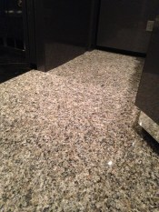 Granite 12x12s going down in the stateroom.
