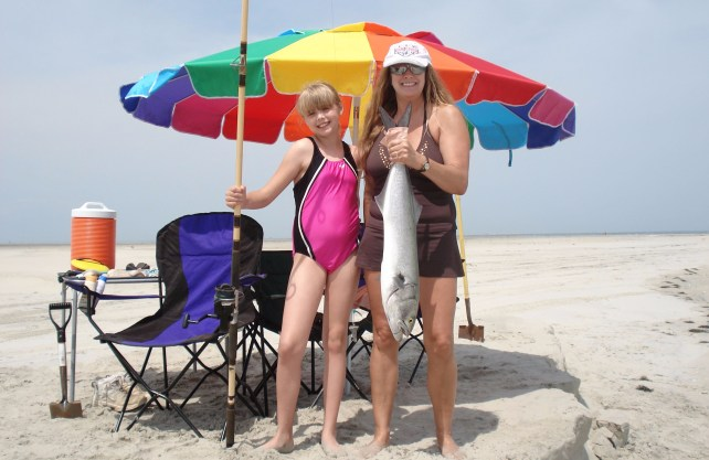 angel and mom on beach with bluefish umbrella