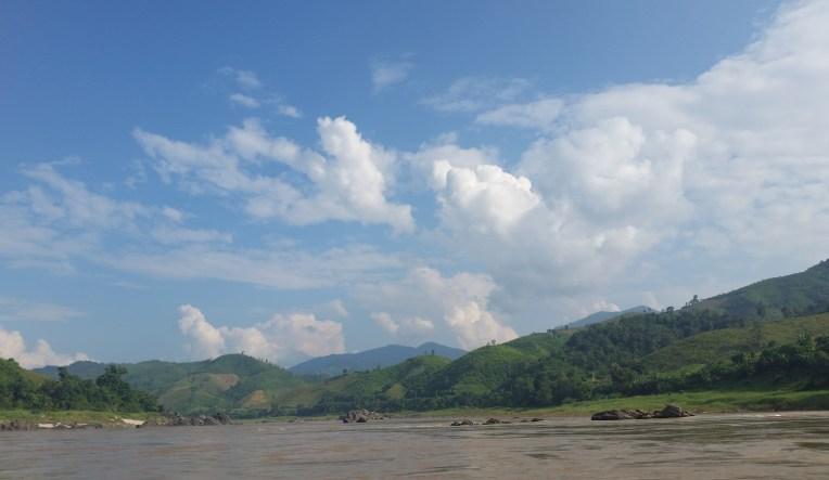 Clouds cap the mountainous Laos jungle & Mekong River