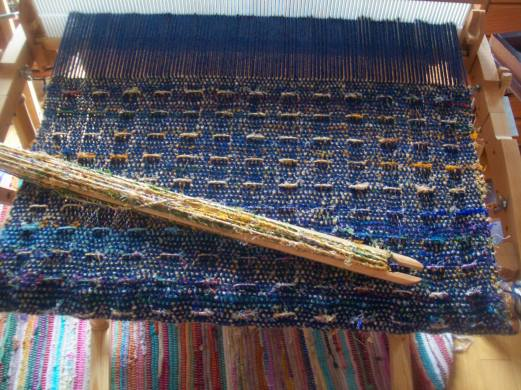 close-up. rigid heddle weaving with simple pickup stick pattern. Cotton warp with sari silk weft
