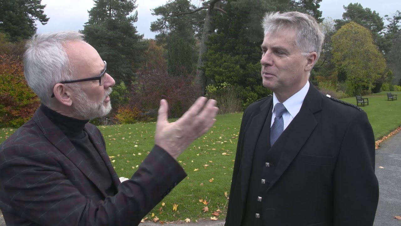 Jack Lee talks to Fergus Muirhead outside Blair Castle at the Glenfiddich Piping Championship 2017