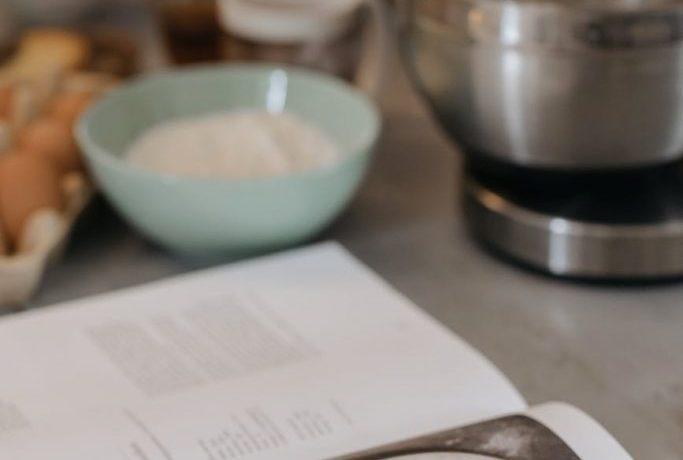 stainless steel bowl beside white ceramic bowl