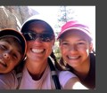 Picture of Lara Robinson with her kids on a memorial day trail run