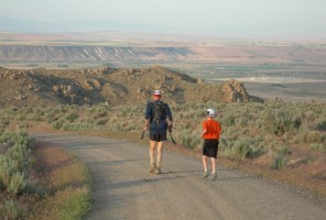 Picture of Dad and son running with trekking poles balanced