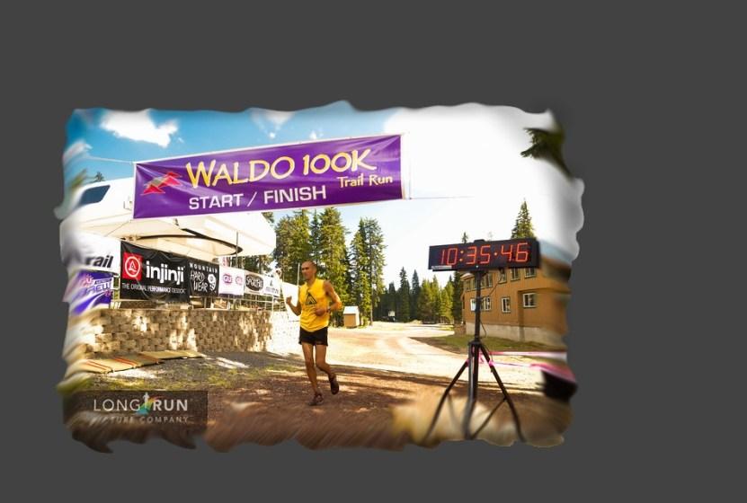 picture of Yassine Diboun crossing the finish line of the waldo 100k ultra marathon