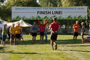 picture of Craig Lloyd congratulating Josh at the finish of the wasatch 100
