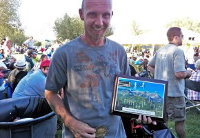 picture of mark kreuzer with buckle and plaque at wasatch 100