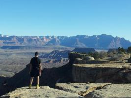picture of runner looking out over the valley at zion 100